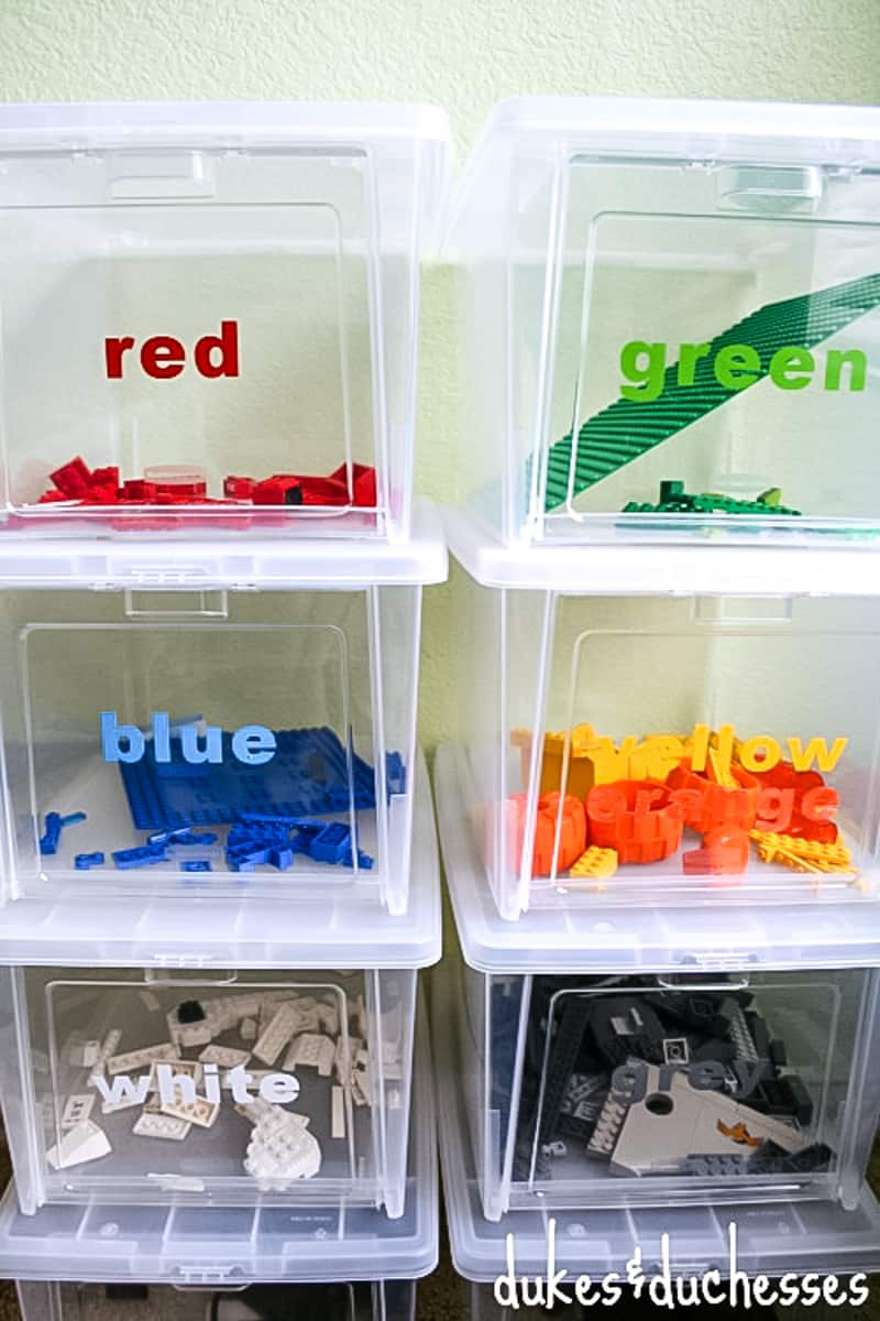 color coded plastic bins for storing Lego pieces