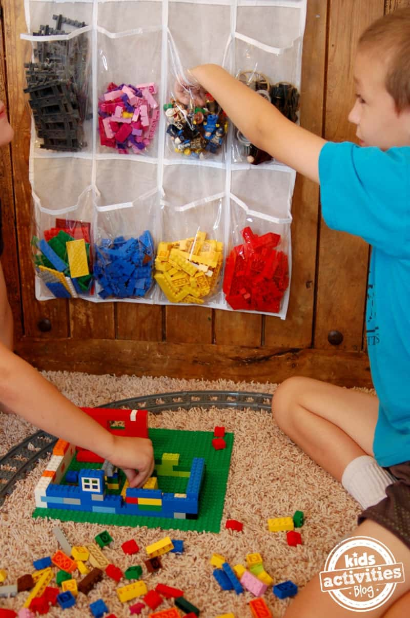 sorting Lego pieces by color in hanging shoe organizer