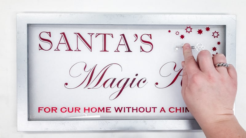 attaching Santa's Magic Key to sign with adhesive clip