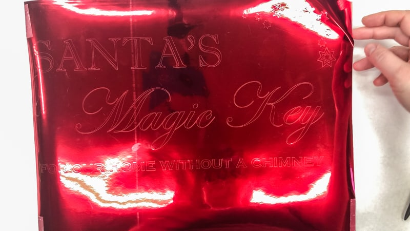 Santa's Magic Key sign text cut from shiny red vinyl on a Silhouette machine