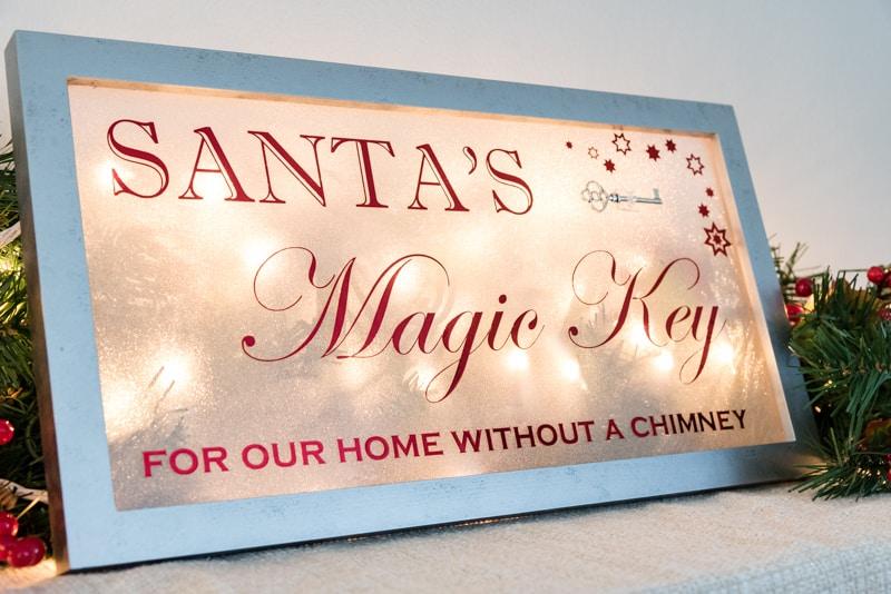 Santa's Magic Key sign lit up from behind