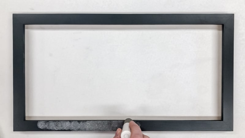 painting black frame with silver paint and foam pouncer