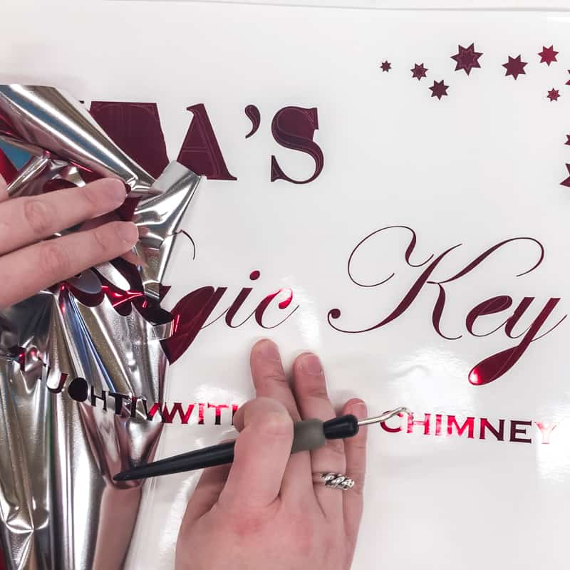 Removing excess vinyl from Santa's Magic Key sign text