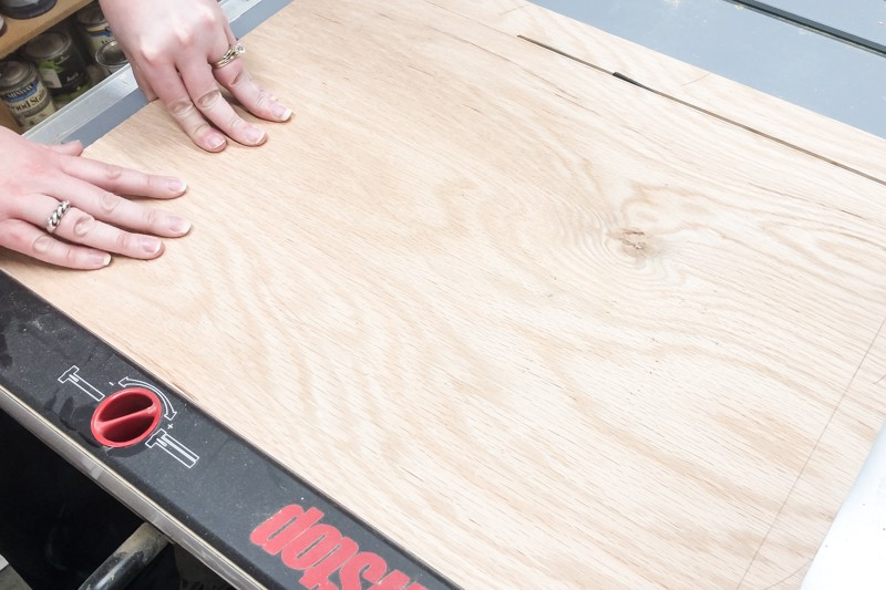 cutting plywood on a table saw for an entryway mirror