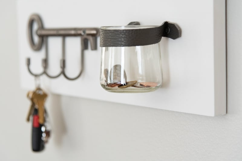 key shaped key hooks and change jar held to entryway mirror with leather strap