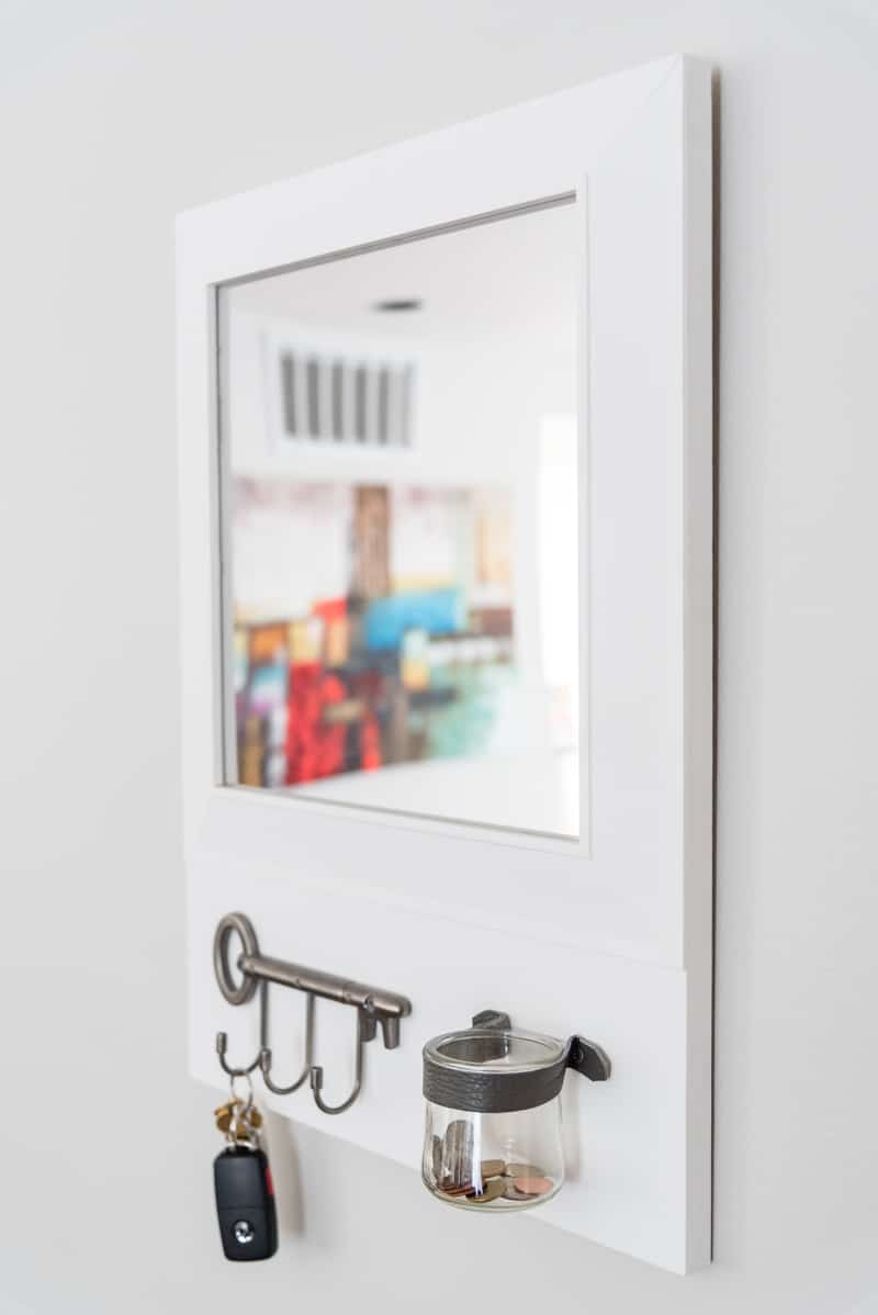 DIY entryway mirror with key hooks and change jar