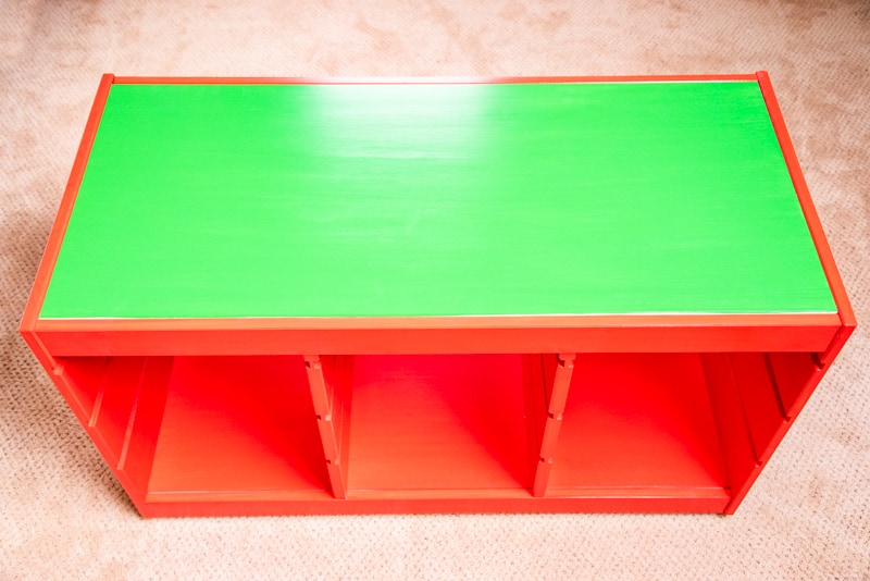 completed IKEA Trofast frame painted red with green top