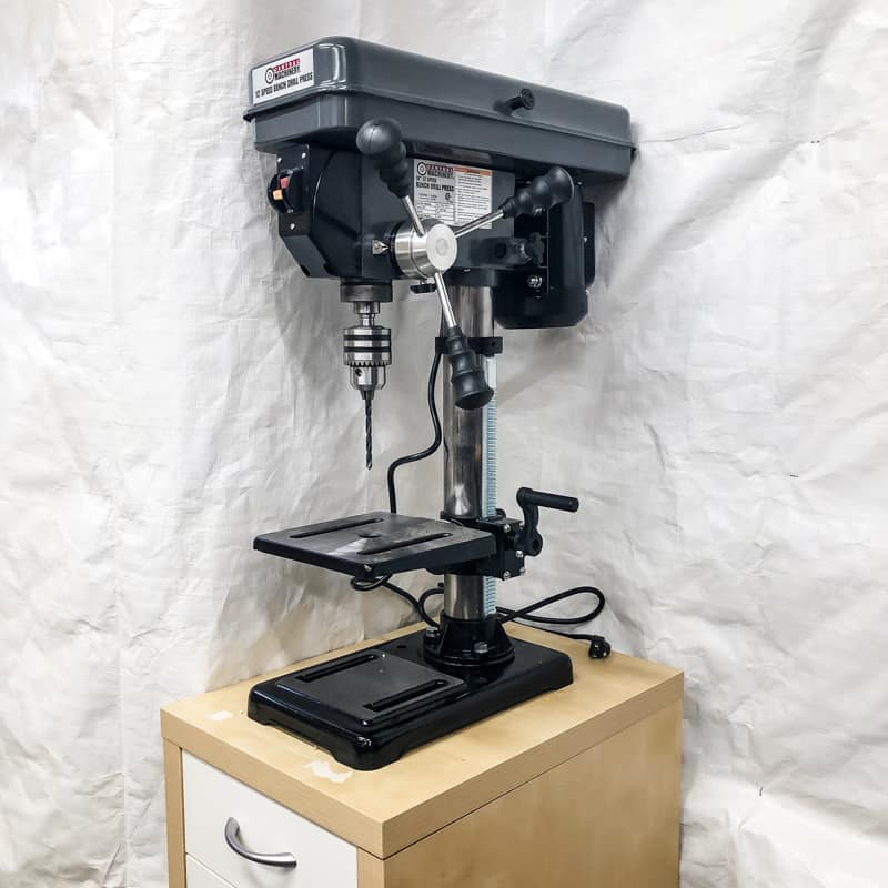 drill press on IKEA cabinet stand with white tarp background