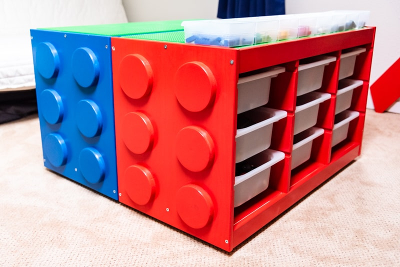 two IKEA Lego tables made from IKEA Trofast drawer units, made to look like giant Lego bricks