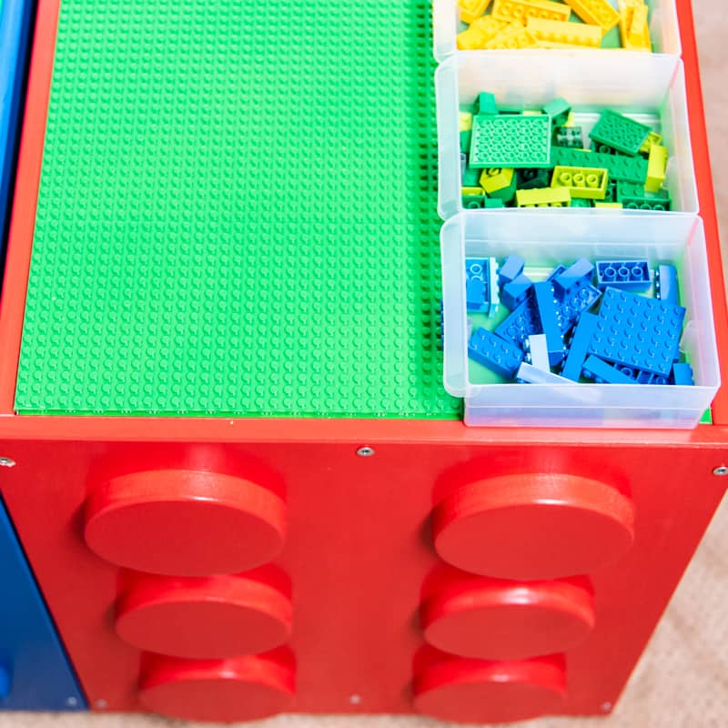 IKEA Trofast Lego table with Lego dots on side and bins on top