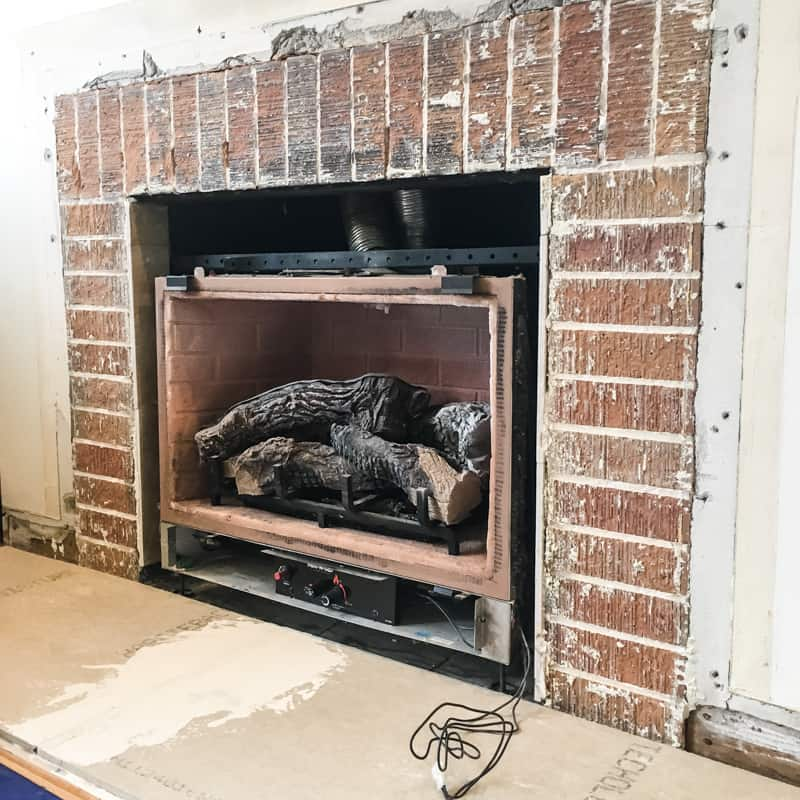 fireplace hearth replaced with new concrete backer board to prepare for tile