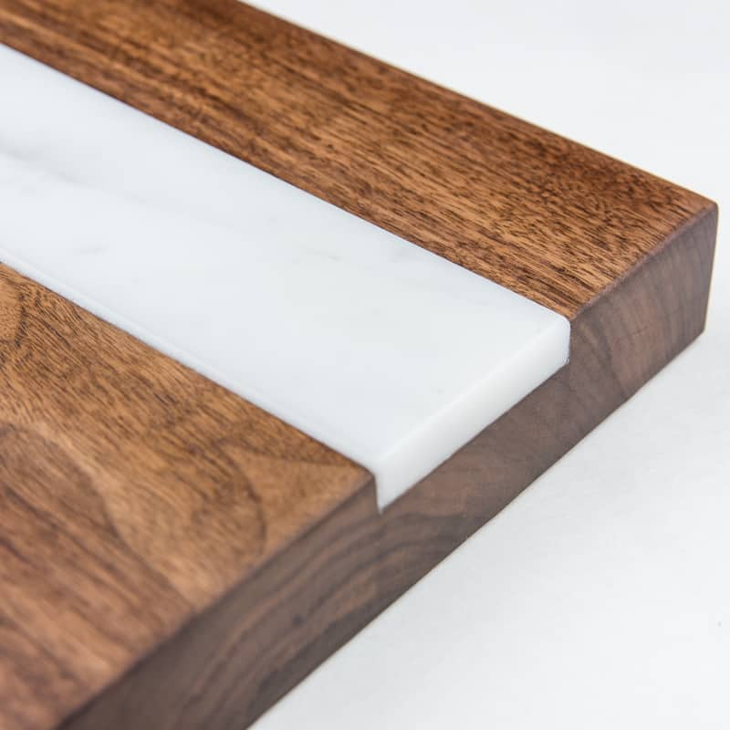 detail of marble inlay in walnut cutting board