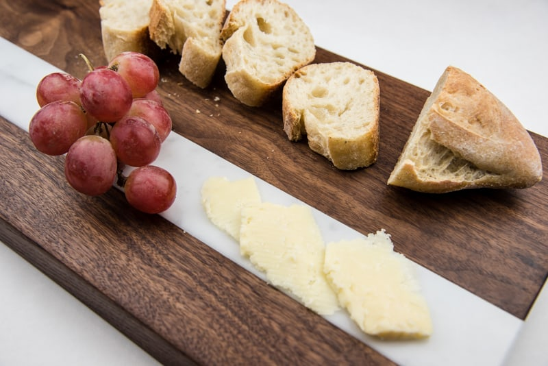 cheese and bread on DIY cutting board with marble inlay
