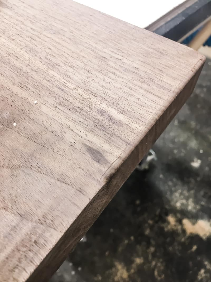 walnut board with sharp corner and rounded over corner for comparison