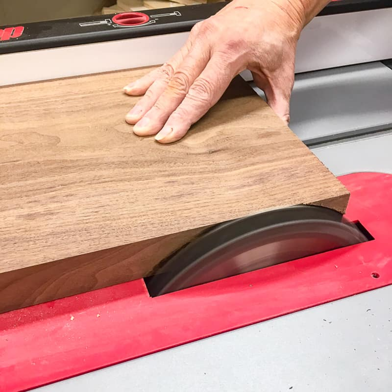 squaring up the edge of the cutting board with the table saw