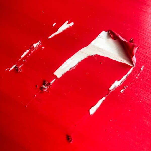 peeling red paint on pine furniture