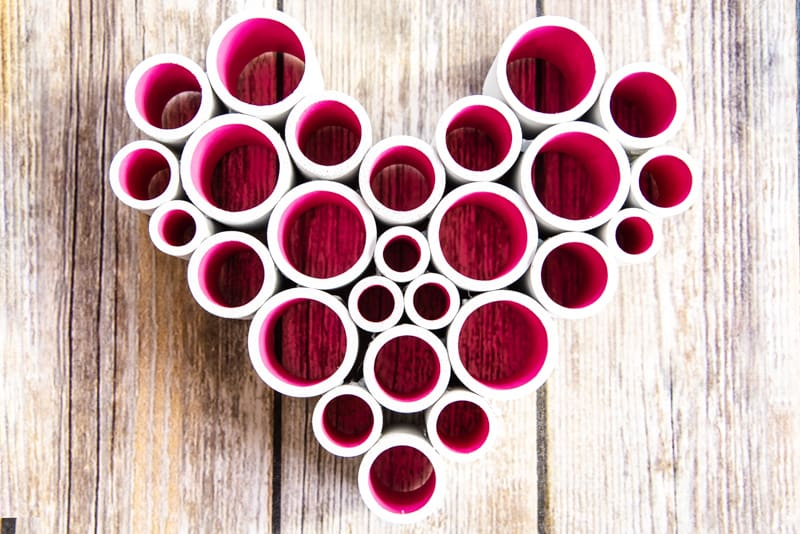 PVC pipe heart on a wood background