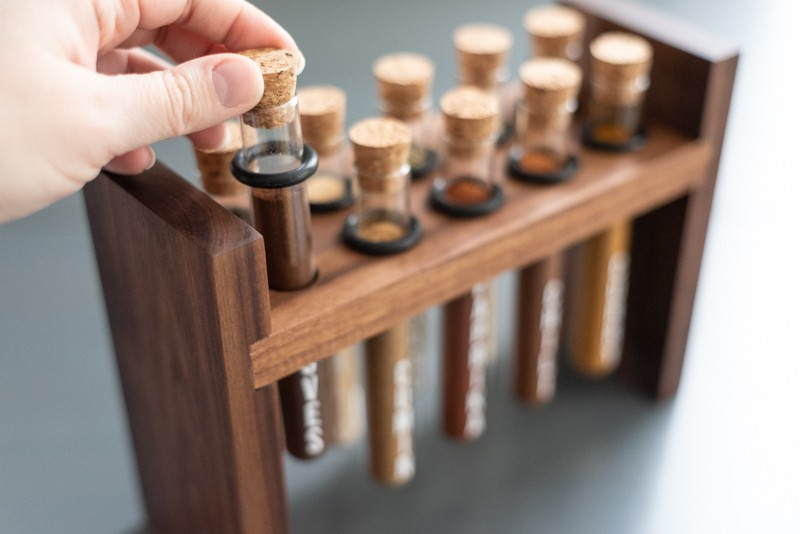 pulling one test tube out of DIY spice rack