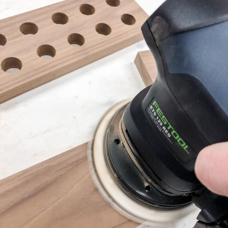 sanding walnut board with a Festool sander