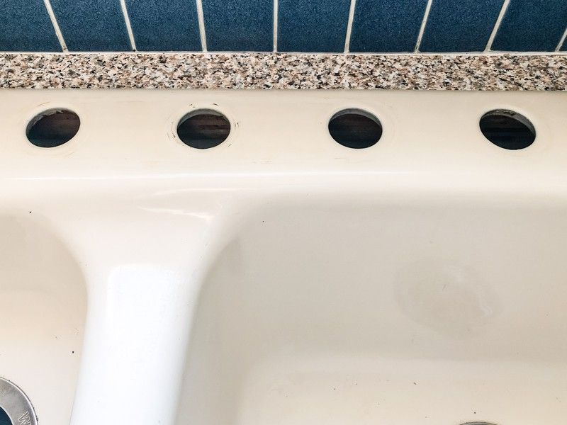 four hole kitchen sink cleaned for new faucet