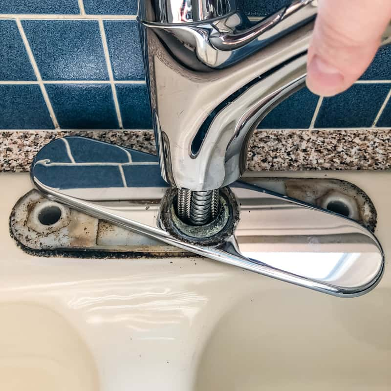 pulling out old kitchen faucet