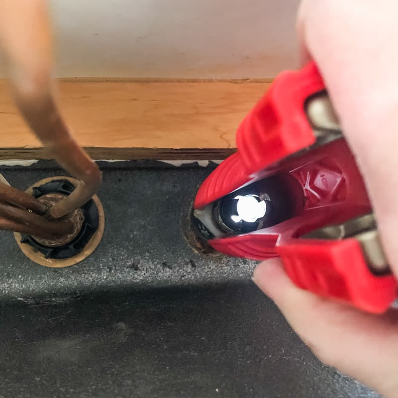 using the Ridgid faucet tool to remove the plastic nut for the soap dispenser under the sink