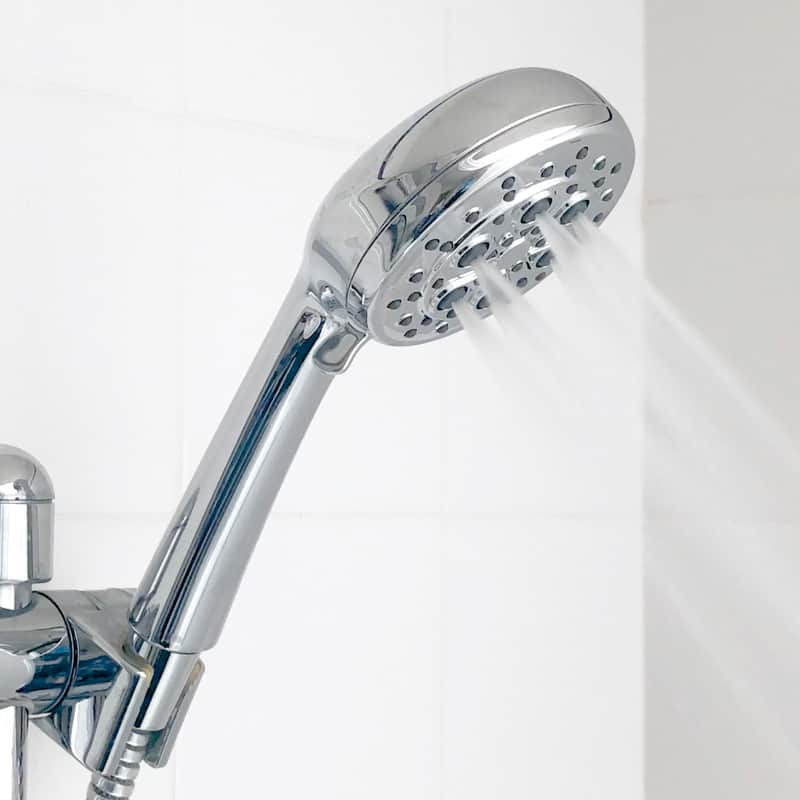 handheld shower head in bracket turned on
