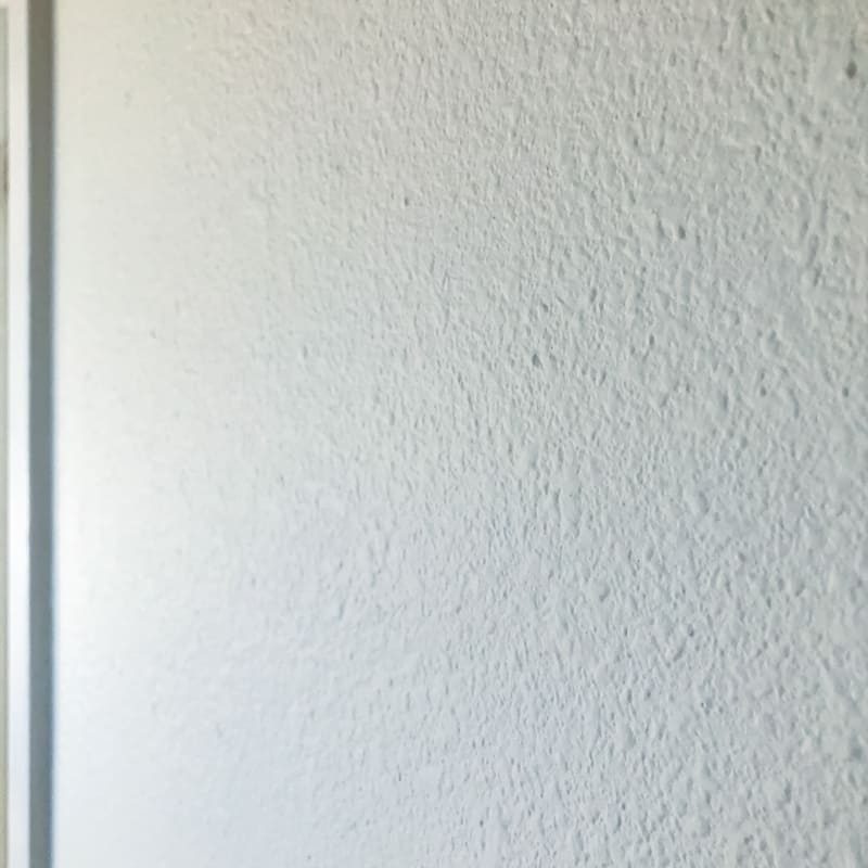 white heavily textured wall