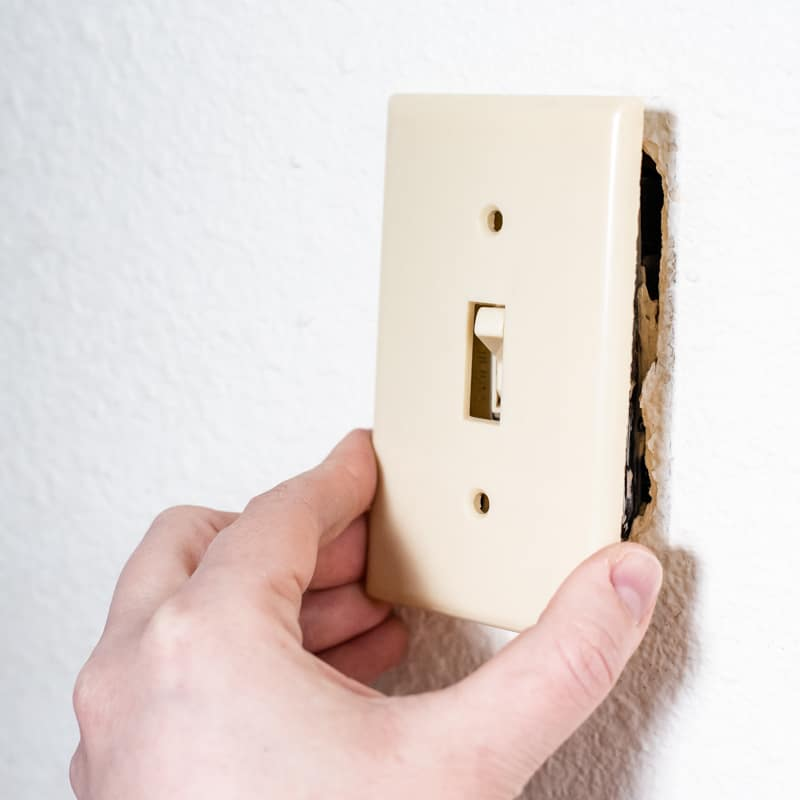 removing almond colored switch plate before painting textured walls