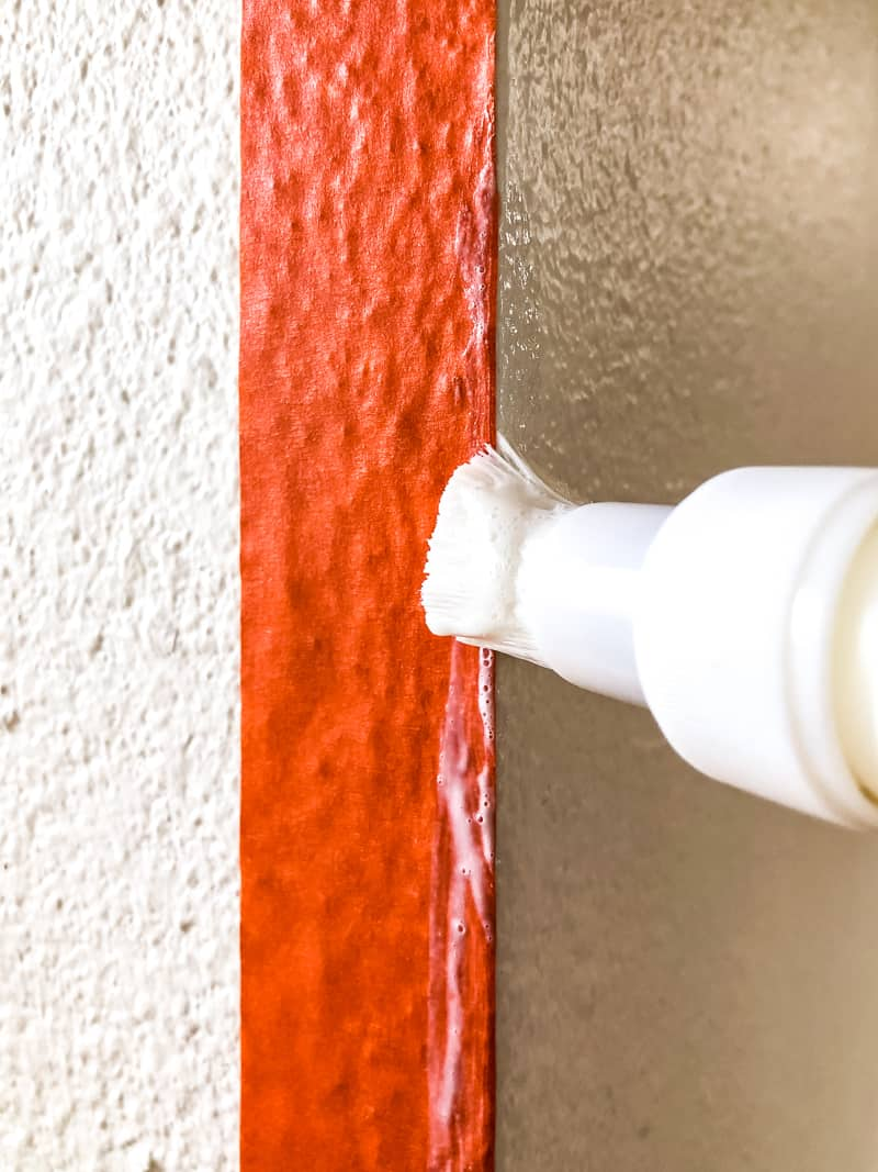 applying Frogtape Textured Wall Tape and Sealer to corner of textured wall surface