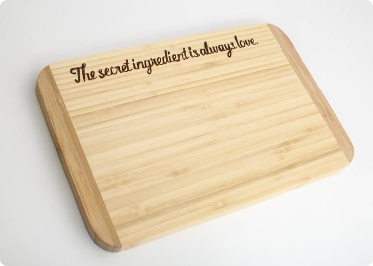 cutting board with custom wood burned message