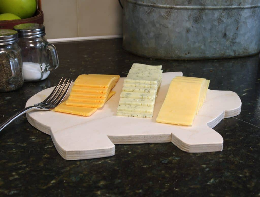 pig shaped cutting board with cheese slices