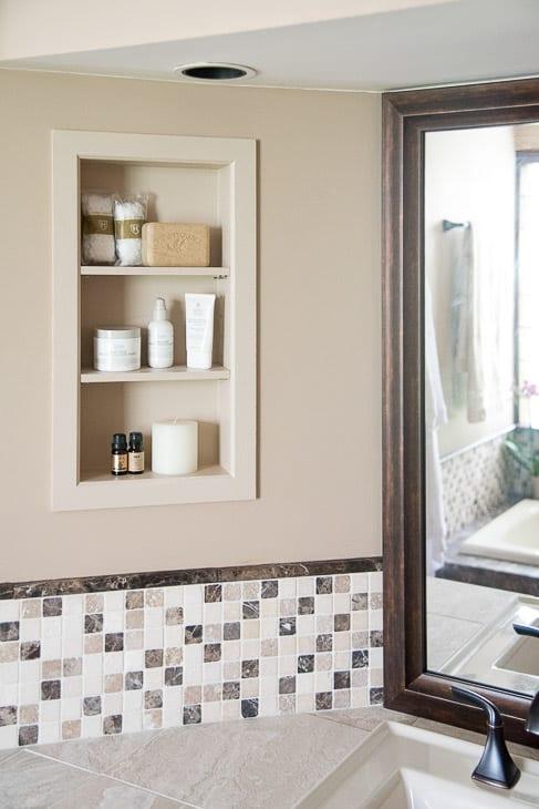 recessed bathroom shelves above vanity countertop