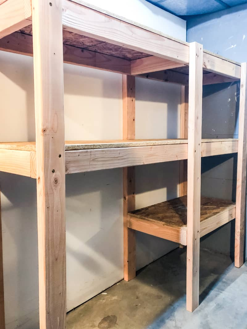 custom sized garage shelves with space for suitcases