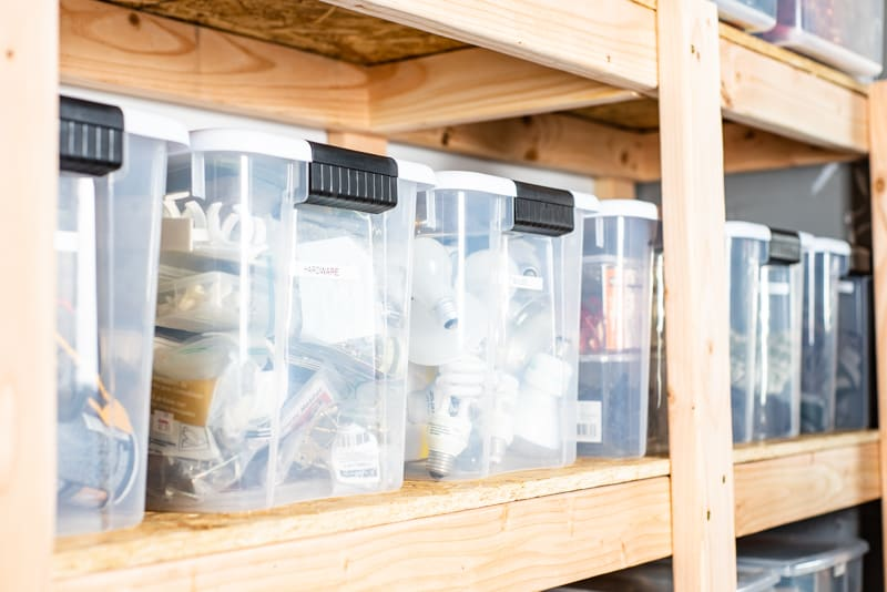 plastic bins on DIY garage shelves