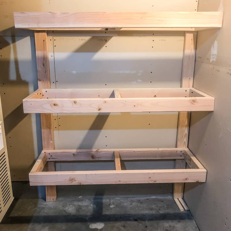 DIY garage shelves frame screwed to wall