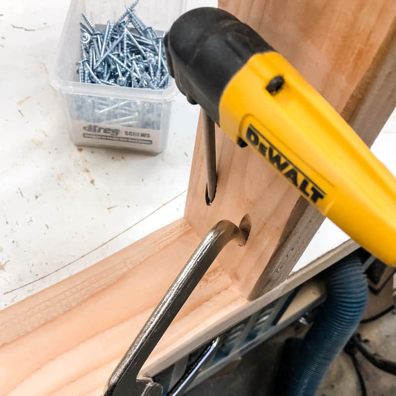 right angle clamp and drill attachment help to assemble garage shelves