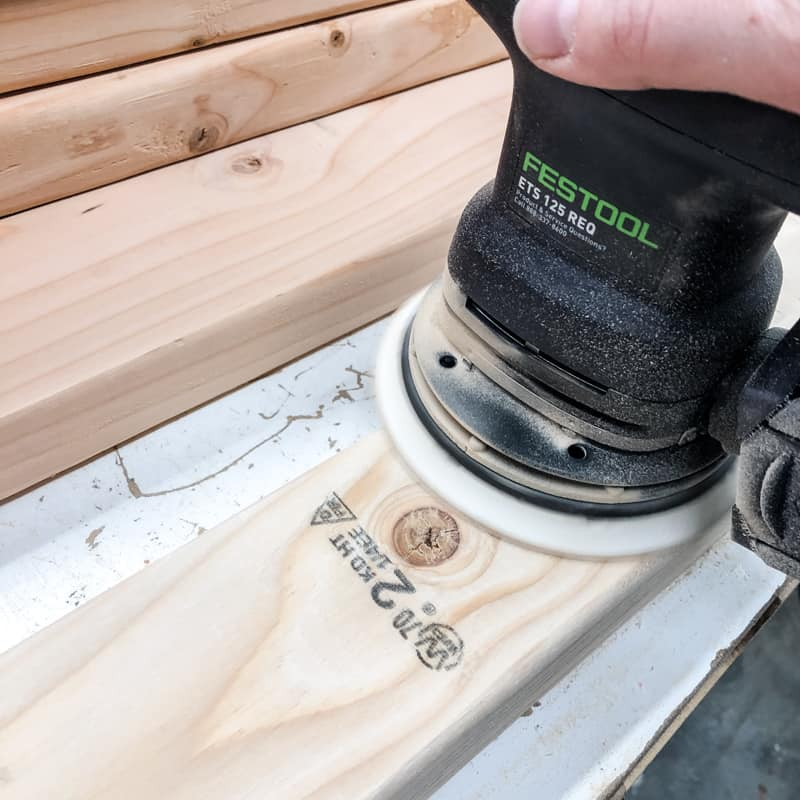 sanding pieces of DIY garage shelves with Festool sander