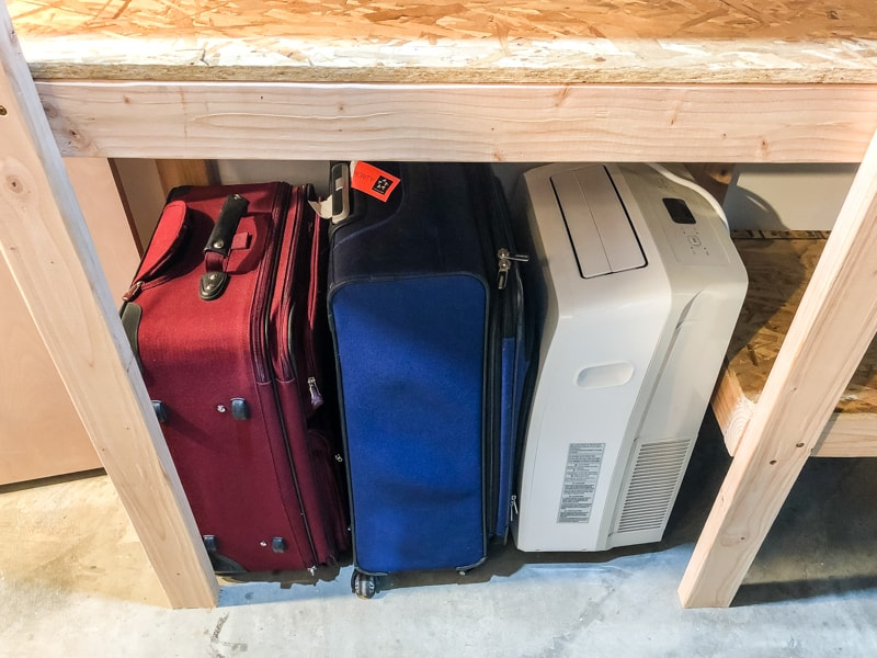 suitcases in custom sized space in garage shelves