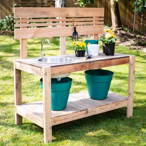 DIY potting bench with sink in grass