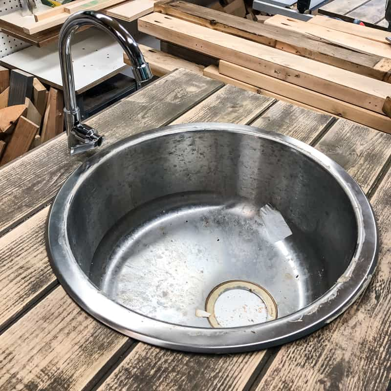 testing fit of sink and faucet in DIY potting bench countertop