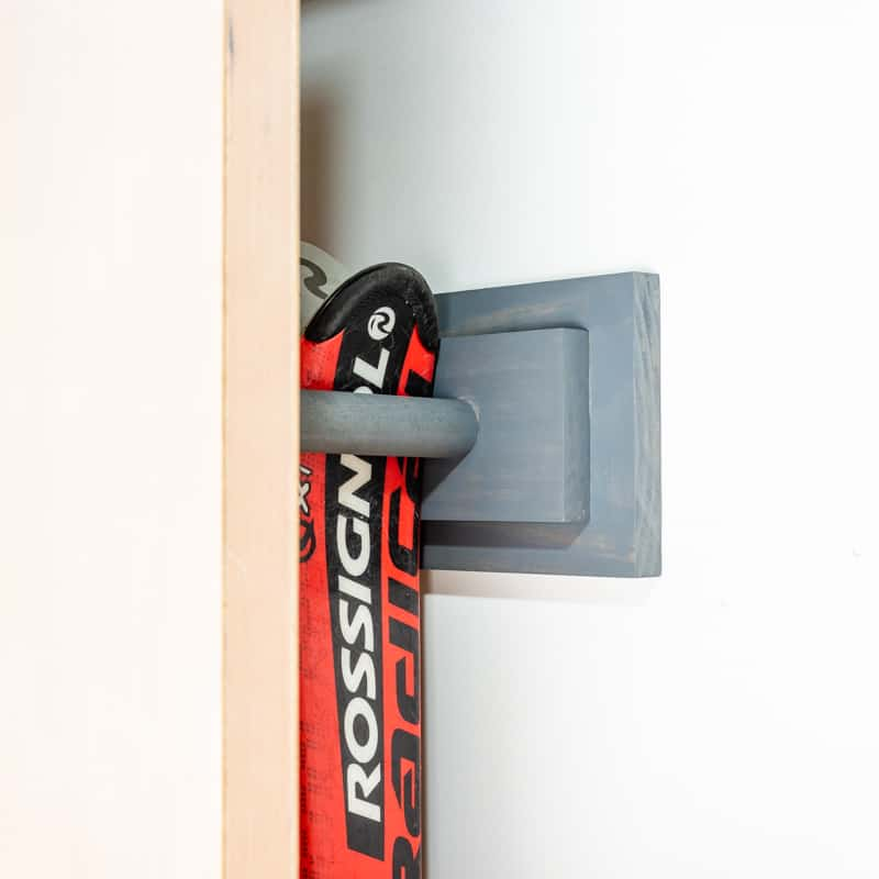 DIY ski rack mounted behind garage door