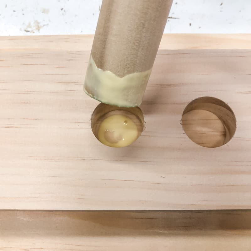 wood glue on bottom of hole and end of dowel
