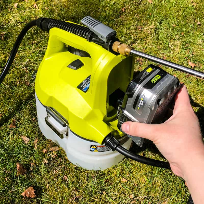 inserting battery into Ryobi chemical sprayer