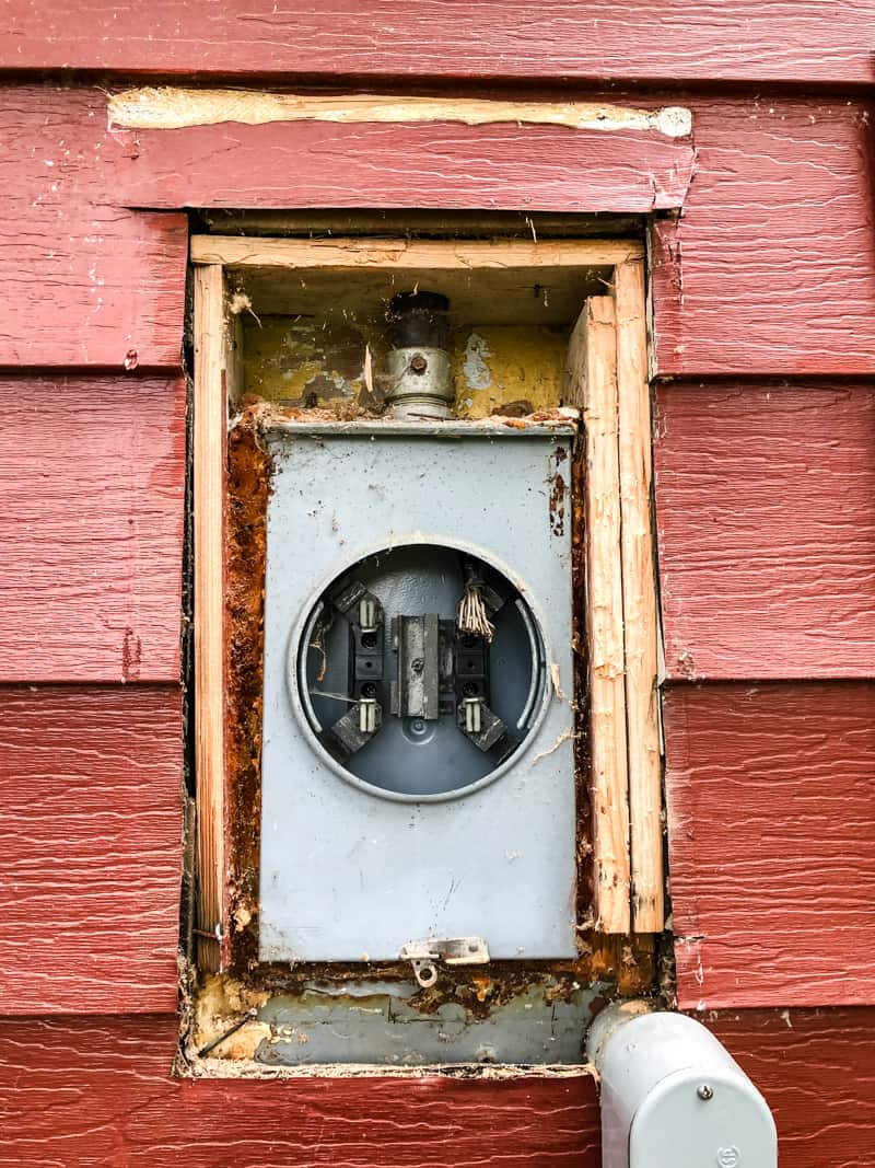 old electric meter in siding of house