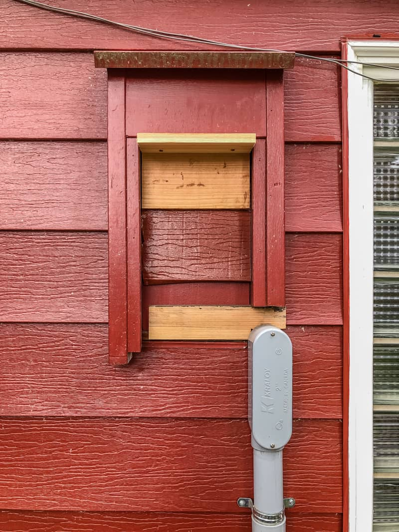 old electric meter framed into siding