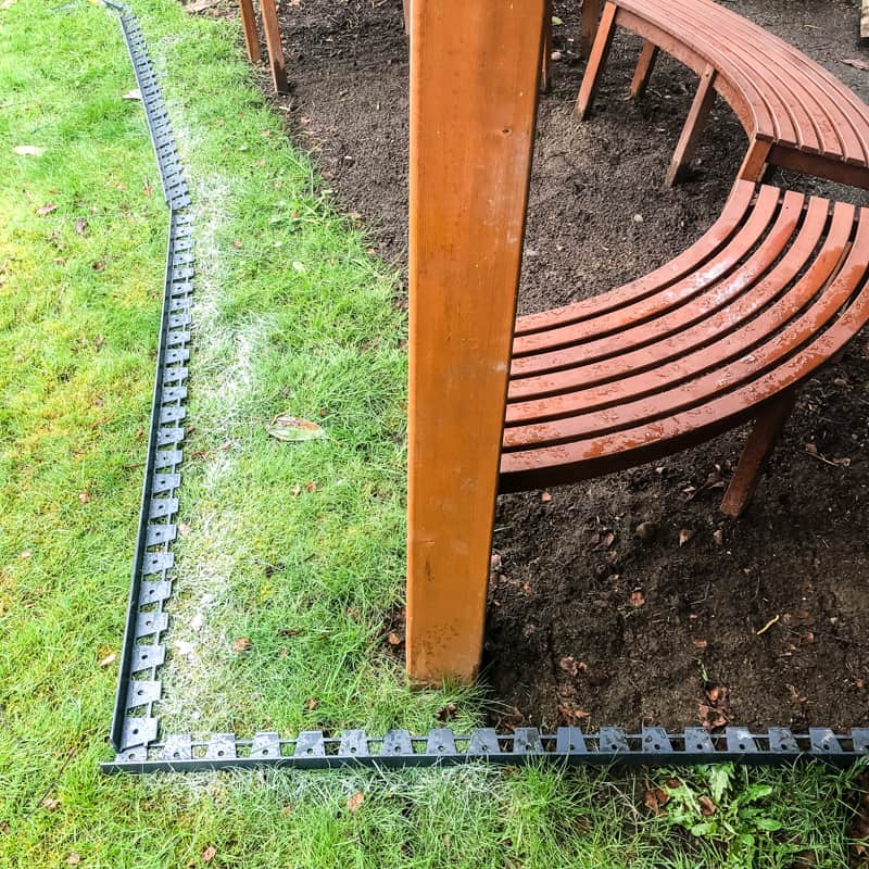 marked out border for pea gravel patio