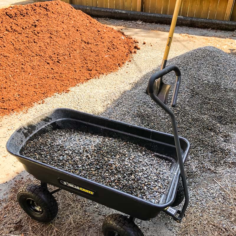 pea gravel and mulch pile in driveway