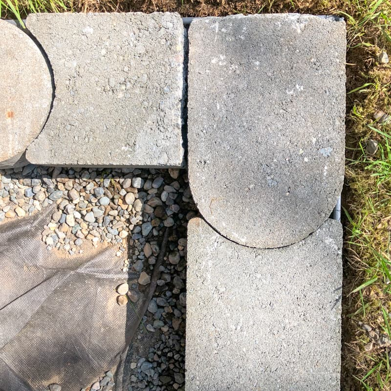 curved concrete pavers forming a 90 degree angle
