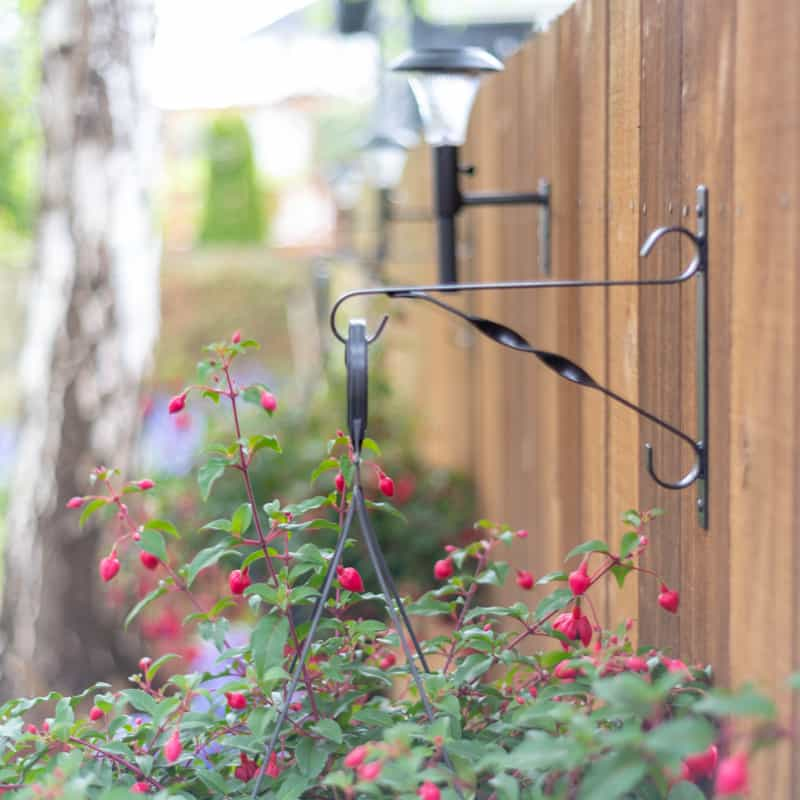 hanging planter basket bracket with solar light bracket in background